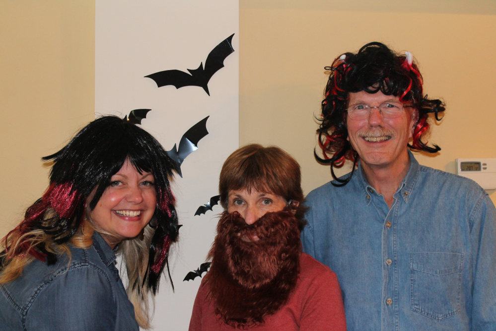 From left, Winthrop Lakes Region Chamber of Commerce Vice President Kim Stoneton, Executive Director Barbara Walsh and President Kim Vandermeulen celebrate Halloween and their new positions on the chamber board.