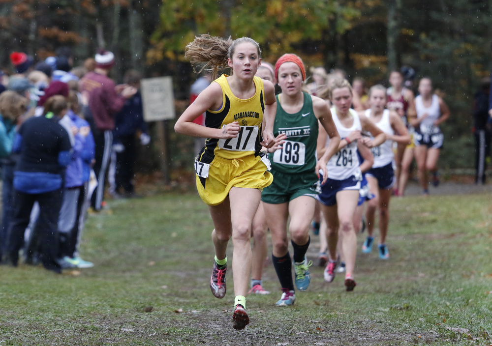 Molly McGrail, center, of Maranacook, competes in the Southern B cross country championships Saturday in Cumberland. She is followed by Julia Labbe, of Leavitt.