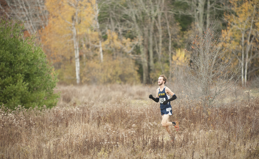 Tucker Barber, of Mt. Blue, finds himself alone as he leads with about 400 yards left in the Northern A cross country championships Saturday in Belfast.