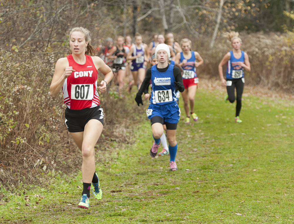Cony's Anne Guadalupi runs during the Northern A cross country championships Saturday in Belfast. She finished second.