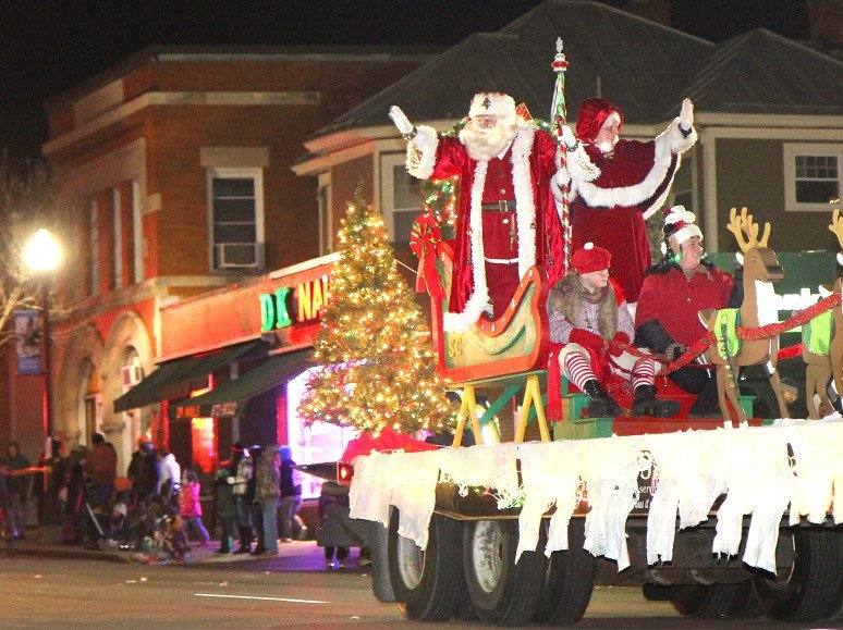 Santa and Mrs. Claus wave to the crowd during the eighth annual Parade of Lights and opening of Kringleville on Nov. 29, 2013, in downtown Waterville.