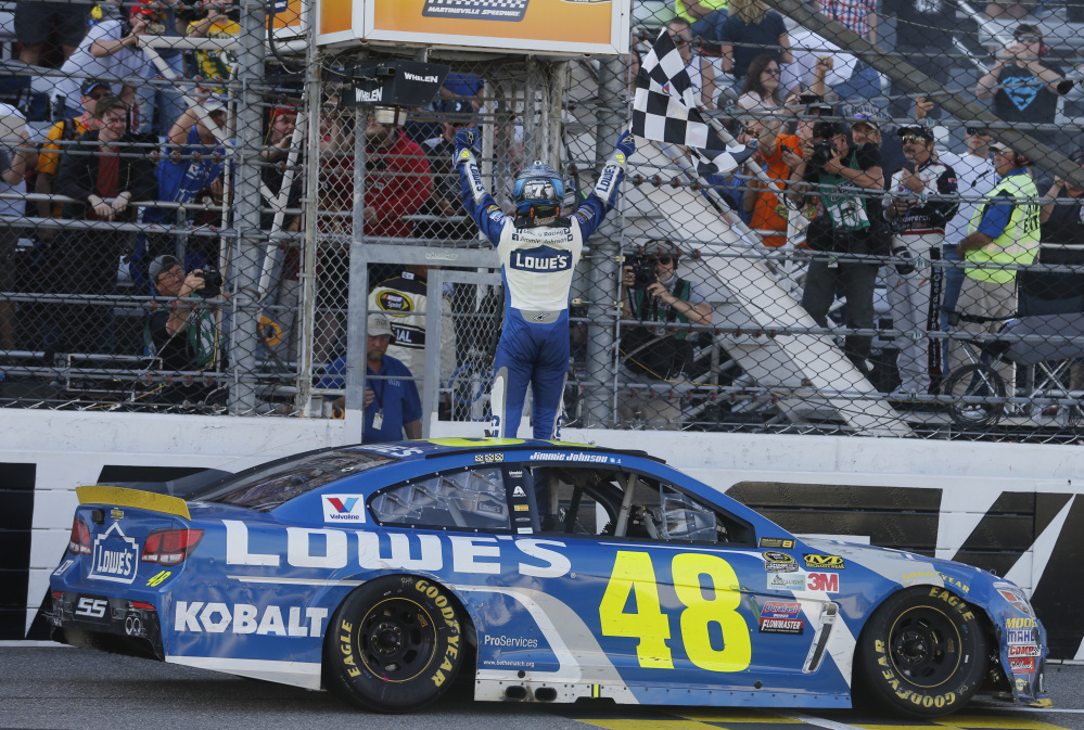 Jimmie Johnson celebrates after winning the NASCAR Sprint Cup Series race Sunday at Martinsville Speedway in Martinsville, Virginia.