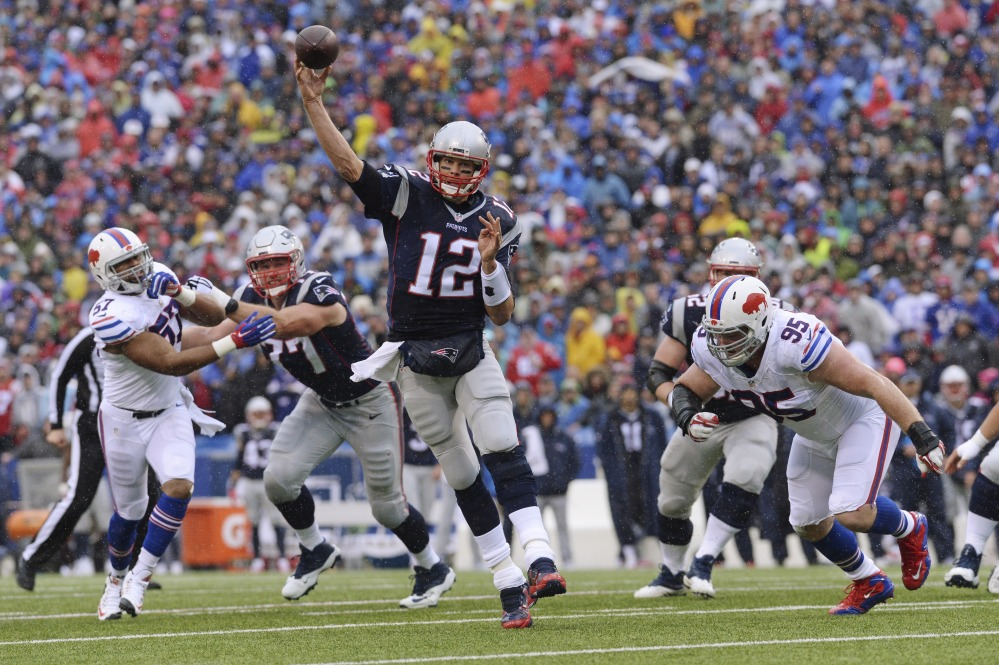 New England Patriots quarterback Tom Brady (12) throws a pass to Danny Amendola for a touchdown during the first half against the Buffalo Bills on Sunday in Orchard Park, New York.