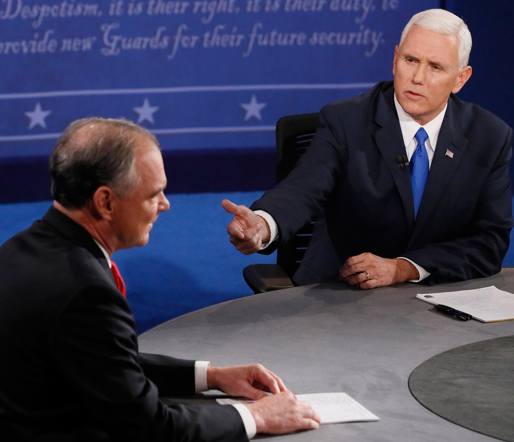 Republican vice presidential nominee Mike Pence, right, detailed his conservative agenda on tax policy, entitlements and immigration during Tuesday night's debate. Andrew Gombert/Pool via AP