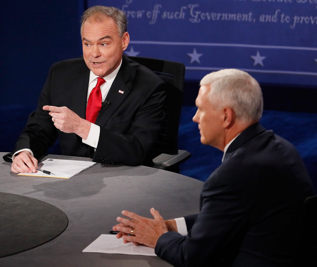 Democratic vice presidential nominee Tim Kaine, left, went on the attack from the start of Tuesday night's debate, pressuring Republican Mike Pence to answer for some of Donald Trump's provocative statements. Andrew Gombert/Pool via AP
