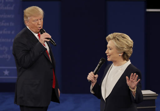 Donald Trump and Hillary Clinton speak during the second presidential debate at Washington University in St. Louis on Sunday. (AP Photo/Patrick Semansky)