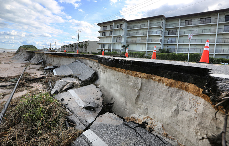 Erosion caused by high surf from Hurricane Matthew takes a chunk of the beachside-road in Ormond-By-The-Sea, Fla.