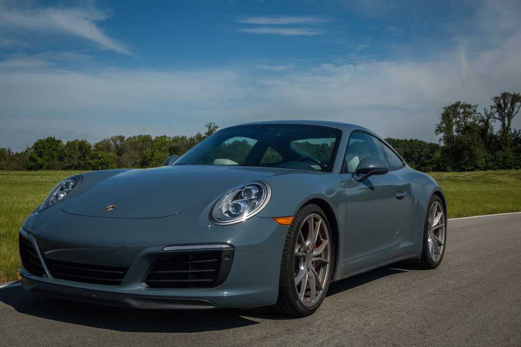 The 2017 Porsche 911 Carrera 4S comes with a button to raise the suspension 1.5 inches to avoid scraping the splitter when driving over the curb into the driveway.