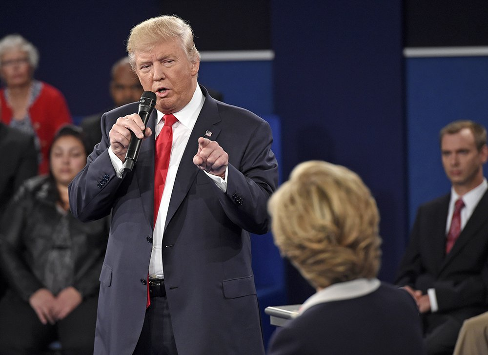 """Republican presidential nominee Donald Trump points at Democratic nominee Hillary Clinton as he speaks during the second presidential debate, in St. Louis, Sunday. His """"jail"""" line was one of the most-discussed debate moments on social media during the debate.<em>Saul Loeb/Pool via AP</em>"""