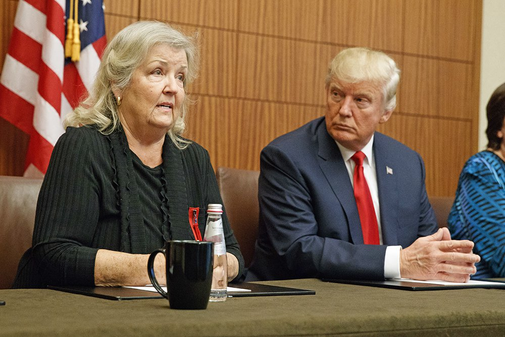 Republican presidential candidate Donald Trump looks on as Juanita Broaddrick, who has accused former President Bill Clinton of sexual assault, speaks before the second presidential debate on Sunday. Associated Press/Evan Vucci