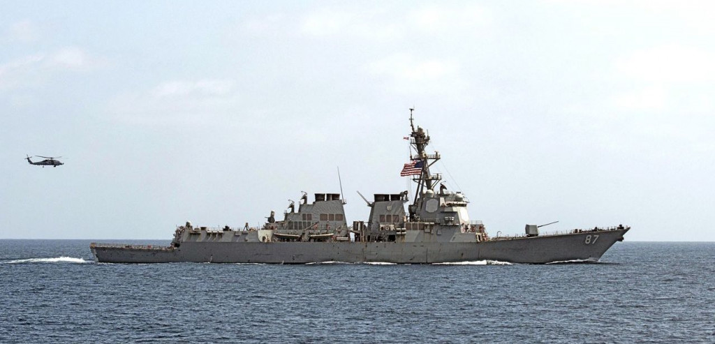 The USS Mason (DDG 87) conducts maneuvers in the Gulf of Oman on Sept. 10, 2016. On Oct. 12, for the second time in a week, two missiles were fired at the Mason in the Red Sea as it conducted operations in the region with the USS Ponce, an amphibious warship. <em>Mass Communication Specialist 1st Class Blake Midnight/U.S. Navy via AP</em>