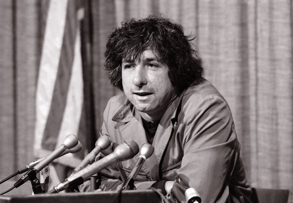Political activist Tom Hayden, answering questions at a news conference in Los Angeles in 1973, says public support was partially responsible for the judge's decision not to send him and others of the Chicago 7 to jail for contempt. <em>Associated Press/George Brich</em>