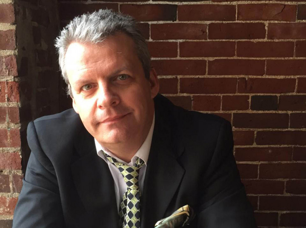 Richard Nickerson, director of choral activities at Windham High School, has been nominated for a Grammy.
