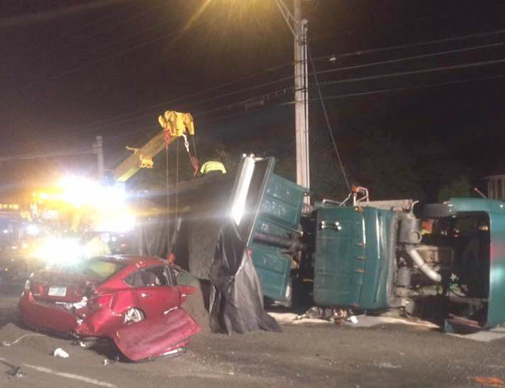 A dump truck overturned and crushed a car as part of a 10-vehicle crash on Route 1 in York on Thursday.
