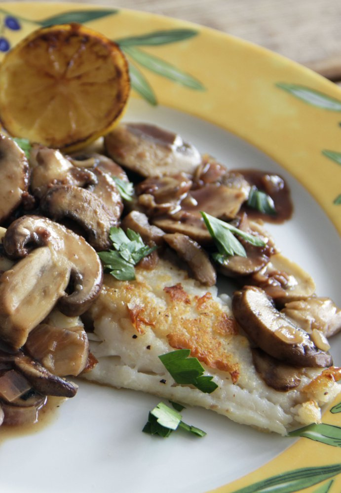 Cod with red wine pan sauce and mushrooms.