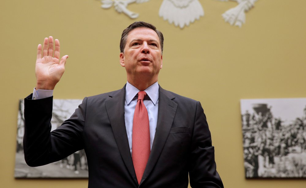 FBI Director James Comey is sworn in before testifying before a House Judiciary Committee hearing in Washington Sept. 28. Officials said he did not notify Congress as soon as he learned about the emails because additional information was needed to proceed.