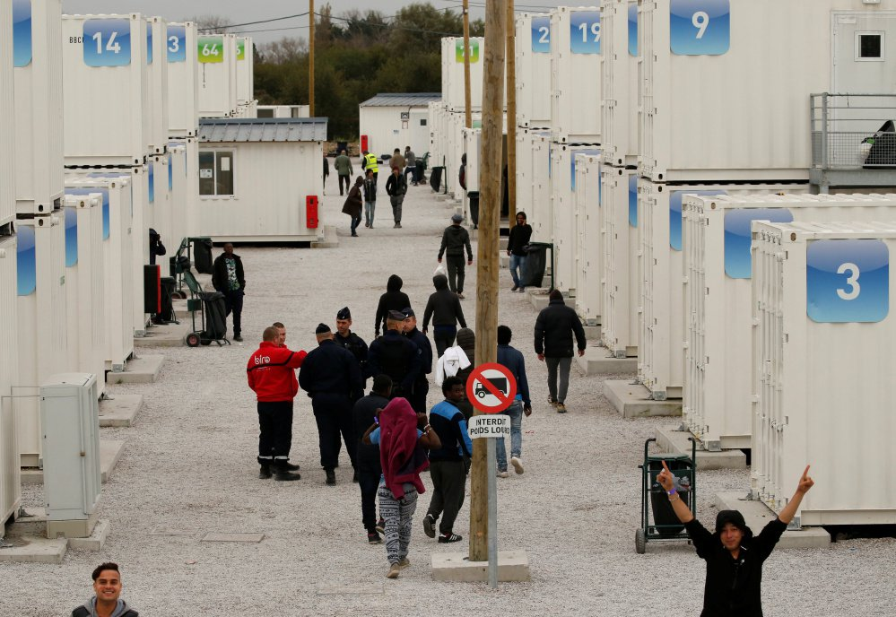 Temporary containers were used to house minors while they stayed in a migrant camp in Calais, France. All unaccompanied children were bused out of the camp Wednesday.