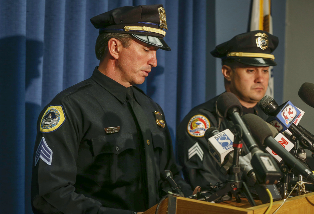 Des Moines Police Sgt. Paul Parizek, left, pauses to fights back emotions as he speaks to media during a news conference Thursday at the Des Moines Police Department in Des Moines, Iowa, regarding the fatal shooting of two officers.
