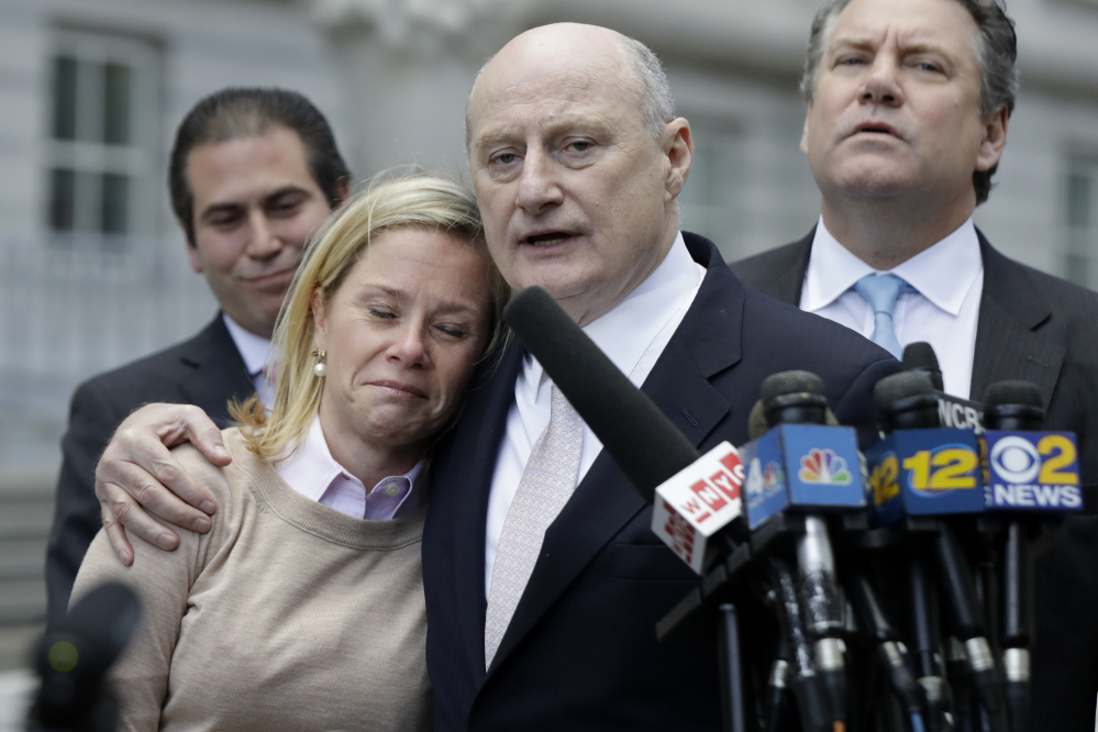 Bridget Anne Kelly, left, former deputy chief of staff for New Jersey Gov. Chris Christie, is held by her lawyer Michael Critchley while talking to reporters after she was found guilty on all counts in the George Washington Bridge traffic trial at Martin Luther King, Jr., Federal Court on Friday in Newark, N.J.