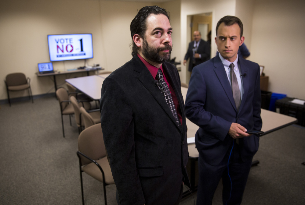 Scott Gagnon, left, of Mainers Protecting Our Youth and Communities stands with Dustin Wlodkowski of WCSH-TV at the Vote No on 1 watch party Tuesday night at the Day One substance abuse center in South Portland.