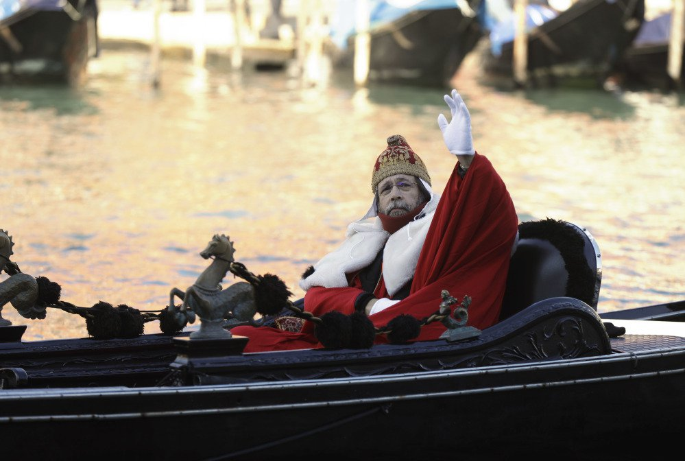 """A protester on a gondola impersonates the """"Doge of Venice"""" during a demonstration against the increasing number of tourists in Venice on Saturday."""