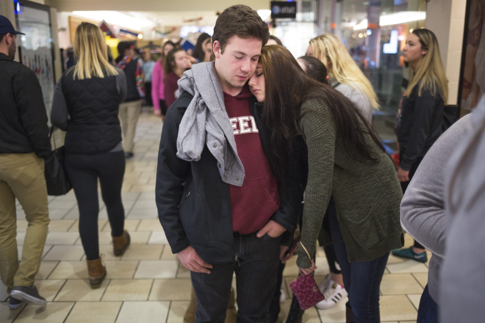 Max Richardson, 17, of Cumberland, and Trinity Turcotte, 16, of Brunswick, wait in line to get into the store Pink just after midnight at the Maine Mall.