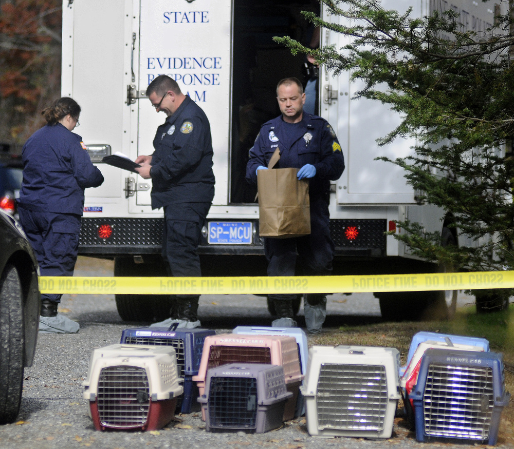 State police collect evidence Monday from the home in Winthrop where the bodies of Antonio and Alice Balcer, both 47, were found after an early morning 911 call. The Winthrop Veterinary Hospital, where Alice Balcer worked, is caring for pets removed from the home.