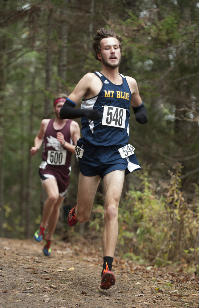Tucker Barber, of Mt. Blue, leads the pack beyond the two-mile mark during the Class A North cross country championships last weekend in Belfast.