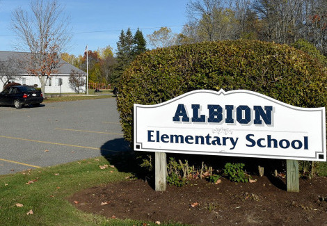 The future of Albion Elementary School is up for debate, with some school board members saying a districtwide elementary school should be built, while others don't want the existing school closed.