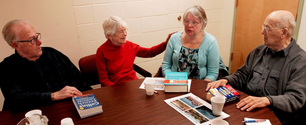 This group regularly meets at Senior Spectrum's Muskie Center in Waterville, where they socialize and speak French to keep the language active in their lives. When they run into a word they forgot or have not used, there are French and English dictionaries available. From left are Gerald Michaud, Cecile Vigue, Claire Ryan and Lucien Veilleux.
