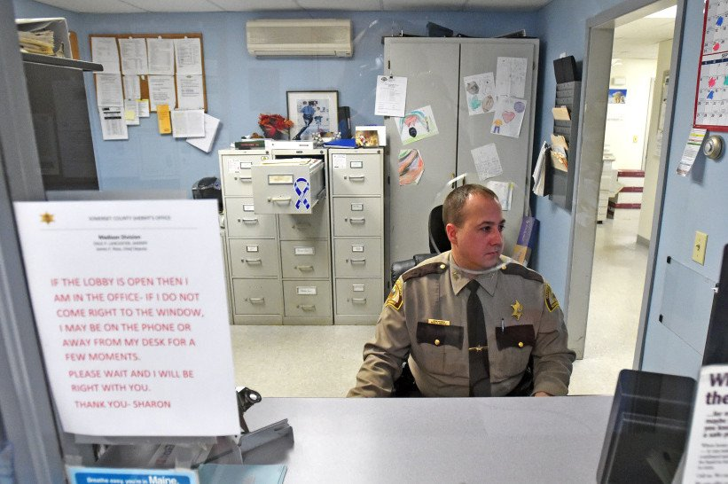 Deputy John Morris, with the Somerset County Sheriff's office, Madison Division, works the desk on Dec. 23, 2015. The Madison Police Department was absorbed by the Somerset County Sheriff's office in 2015, and the town has been reimbursed $79,500 because costs for running the new Madison division came in about 16 percent under budget in its first year.