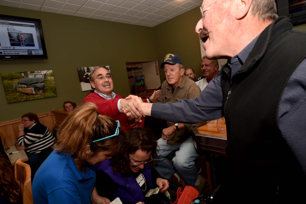 U.S. Rep. Bruce Poliquin visits with supporters at Dysart's Restaurant and Bakery in Bangor after the polls closed on Tuesday.