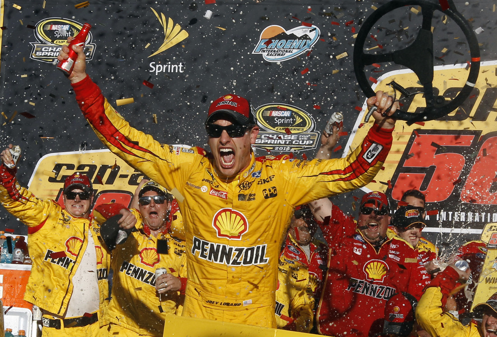 Joey Logano celebrates in the victory lane after winning the NASCAR Sprint Cup Series race on Sunday at Phoenix International Raceway in Avondale, Arizona.