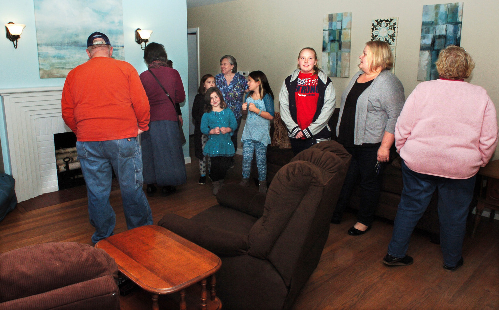 Supporters of Freedom First Support Services take part in a tour Monday during an open house of the Winslow House, the first home in Winslow that creates a learning environment for developmentally disabled people to develop independence skills.