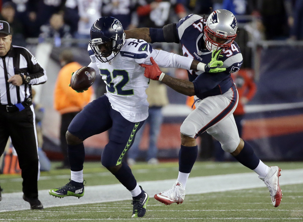New England Patriots linebacker Dont'a Hightower (54) chases down Seattle Seahawks running back Christine Michael during the first half Sunday in Foxborough, Massachusetts.