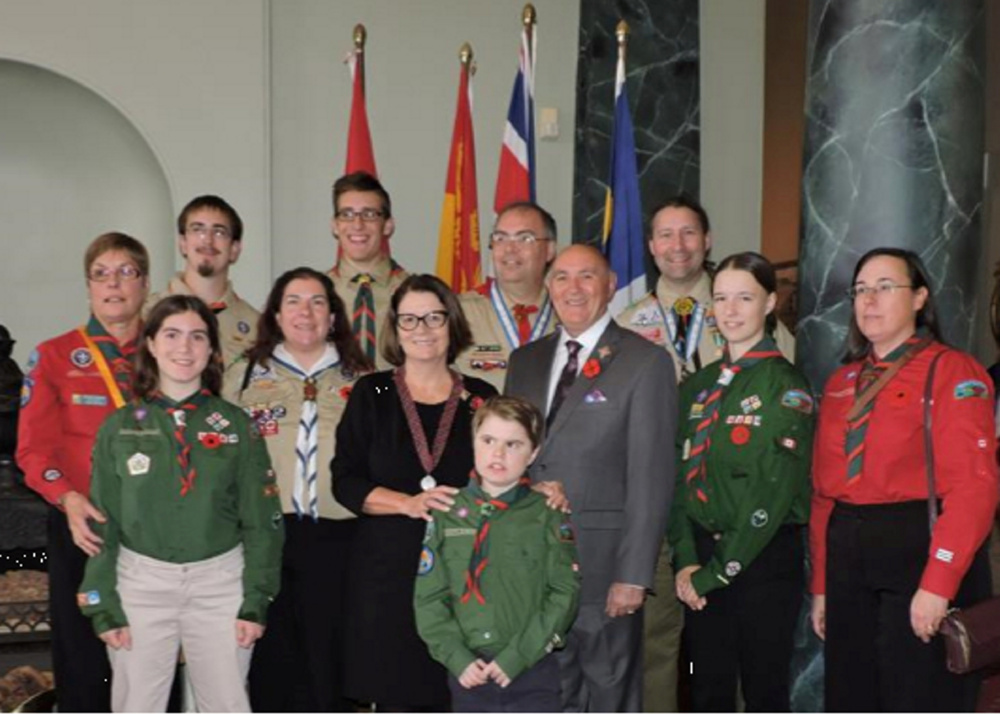 In front is Evan Hardt (1st ketepec). Middle row, from left, is Paige Spears, Yvette Bernier (T433), Lieutenant-Governor of New Brunswick the honorable Jocelyne Roy Vienneau, Ron Vienneau, Emily Hardt (1st Ketepec and Chief Scout), and Julia Chesley (1st Ketepec). In back, from left, is Brenda Graham (Scoutmaster 1st Ketepec) Adam Hutchinson (T433), Holden Cookson (T433), Scott Bernier (KV District), and Chris Bernier (T433).