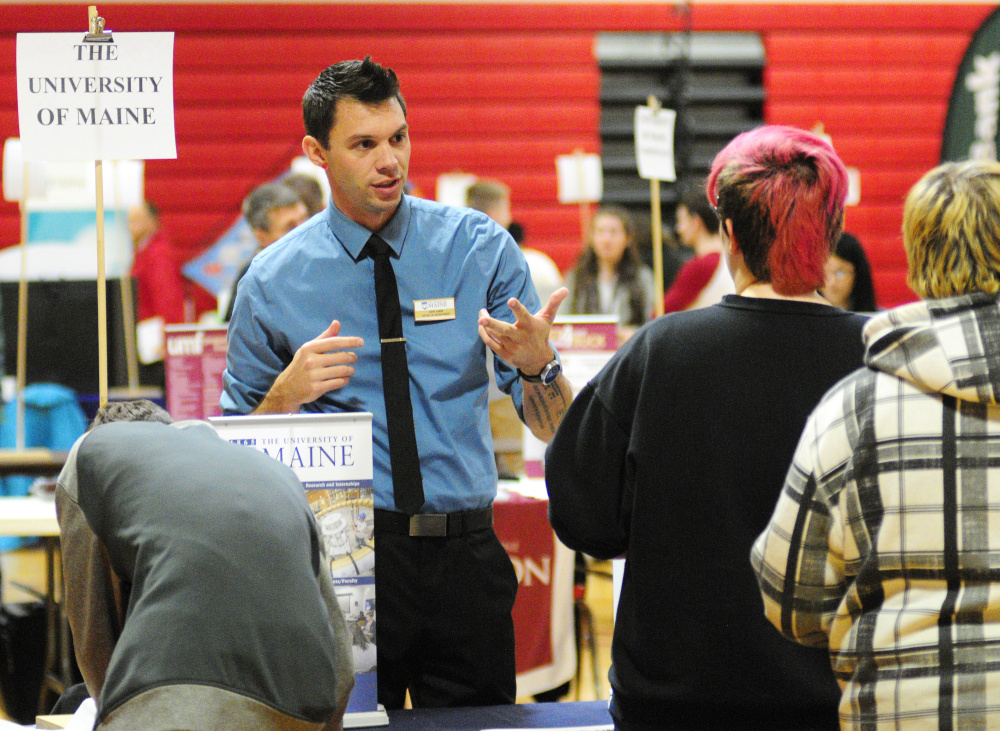 University of Maine representative John Tabor talks to students during a college and career fair Thursday in the Cony High School gymnasium. Representatives from postsecondary schools, business and the military were there to chat with students about opportunities after high school.
