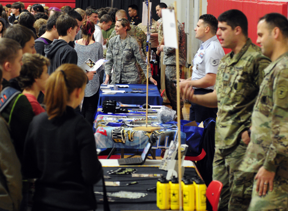 Recruiters from various service branches chat with students Thursday during a college and career fair held in the Cony High School gymnasium.