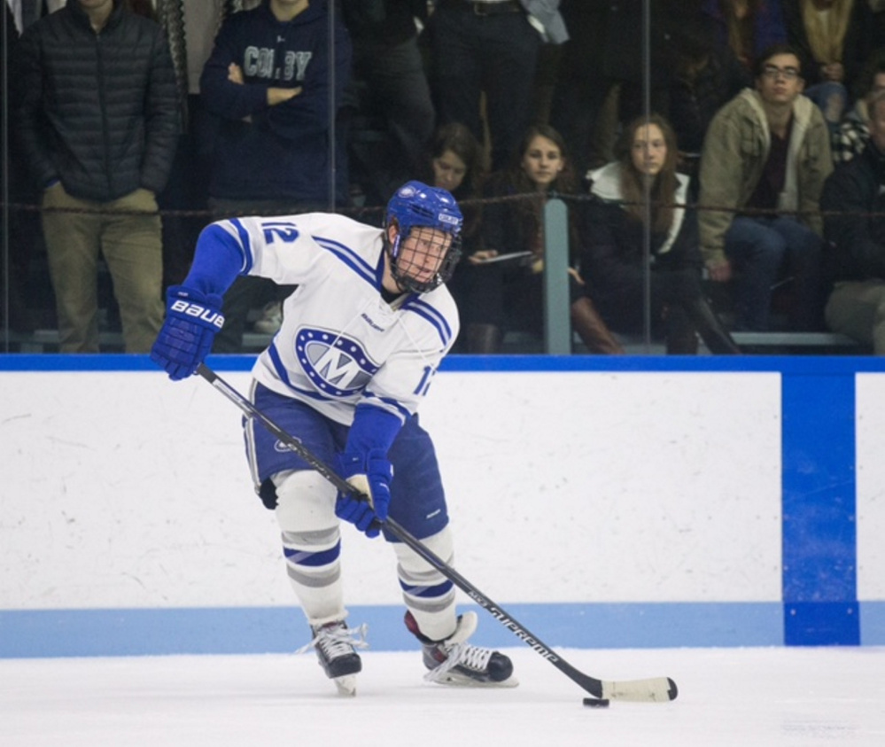 Colby College's Jack Burton looks to pass the puck in a game against Bowdoin College last season at Alfond Rink on the campus of Colby College in Waterville.