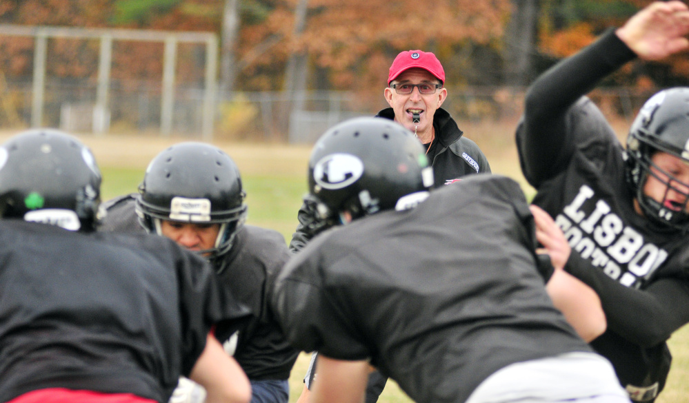 Lisbon head football coach Dick Mynahan watches the team practice Tuesday in Lisbon.
