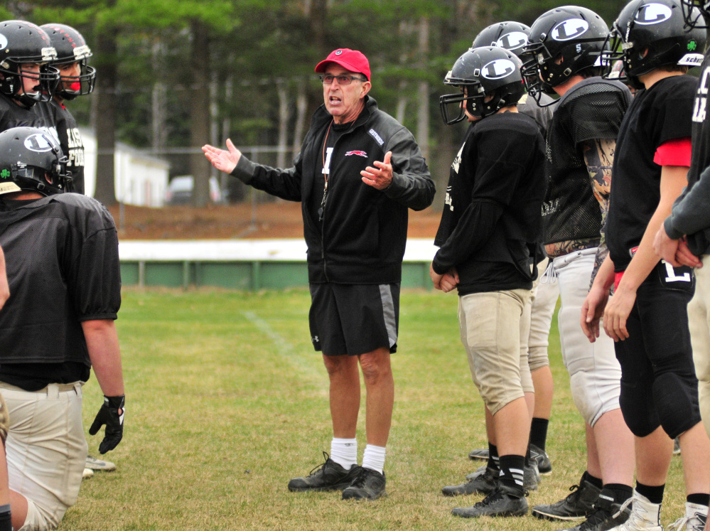 Lisbon head football coach Dick Mynahan goes over some directions during practice Tuesday in Lisbon.