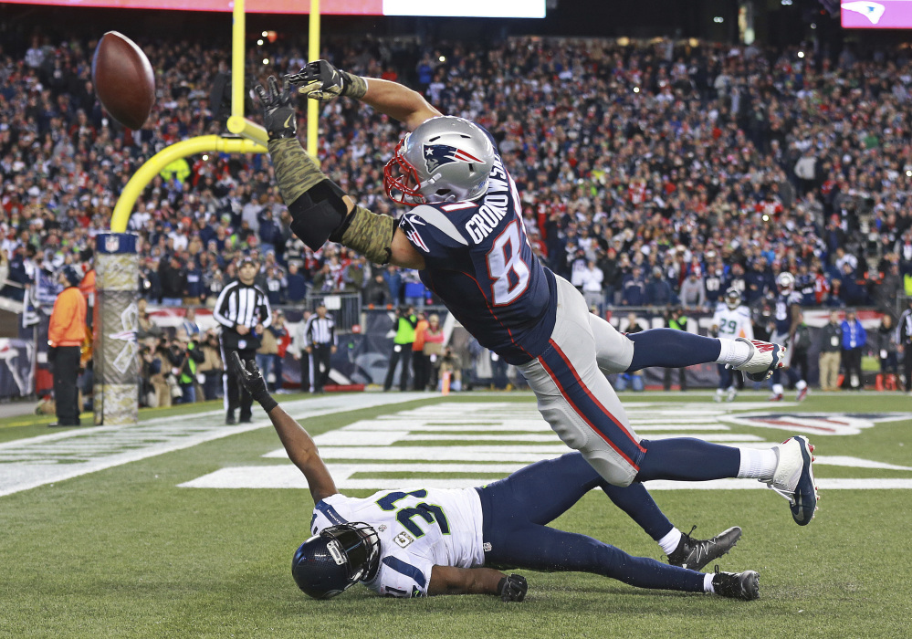 New England Patriots tight end Rob Gronkowski can't catch a pass in the end zone over Seattle safety Kam Chancellor in the final moments of a game last Sunday in Foxborough, Massachusetts.