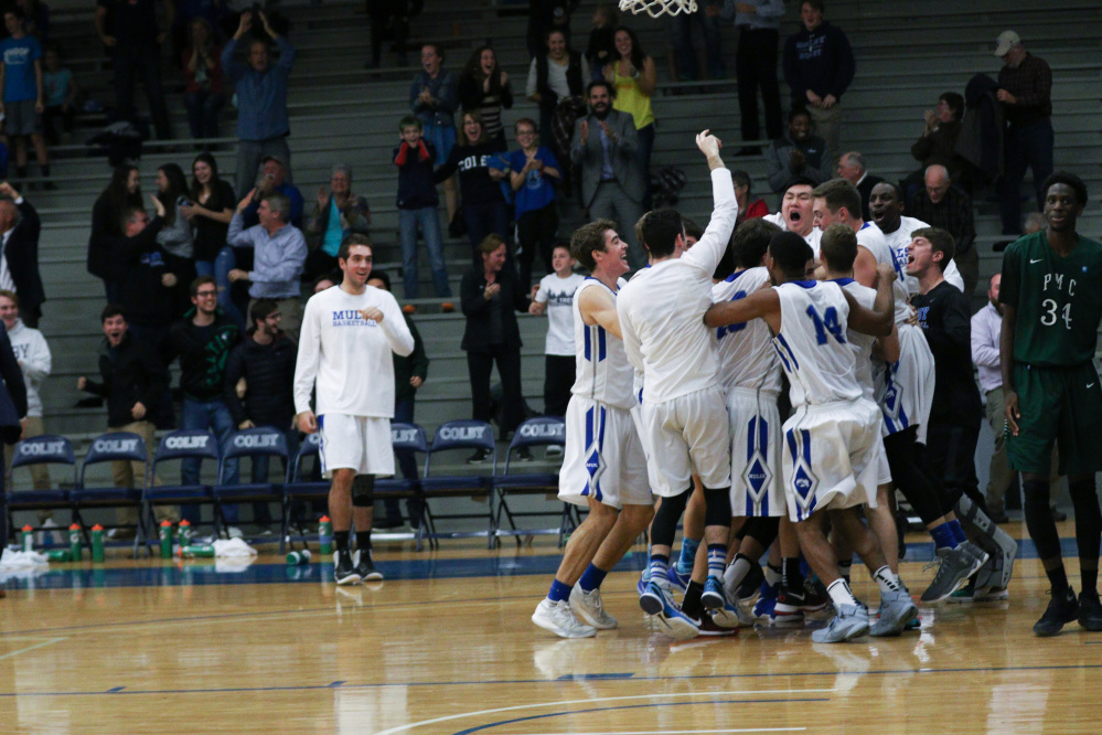 Members of the Colby basketball team celebrate after a 97-96 victory over Pine Manor on Friday in Waterville.