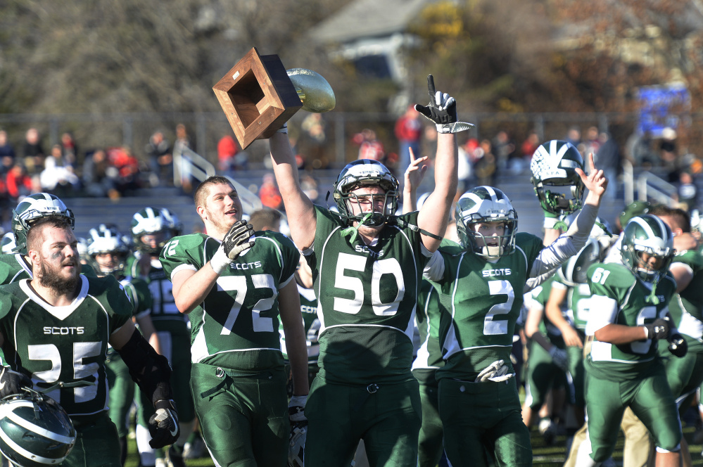 Members of the Bonny Eagle football team — including Parker Gammon with Gold Ball in hand — walk off the Fitzpatrick Stadium field Saturday afternoon after winning the Class A state championship over Portland.
