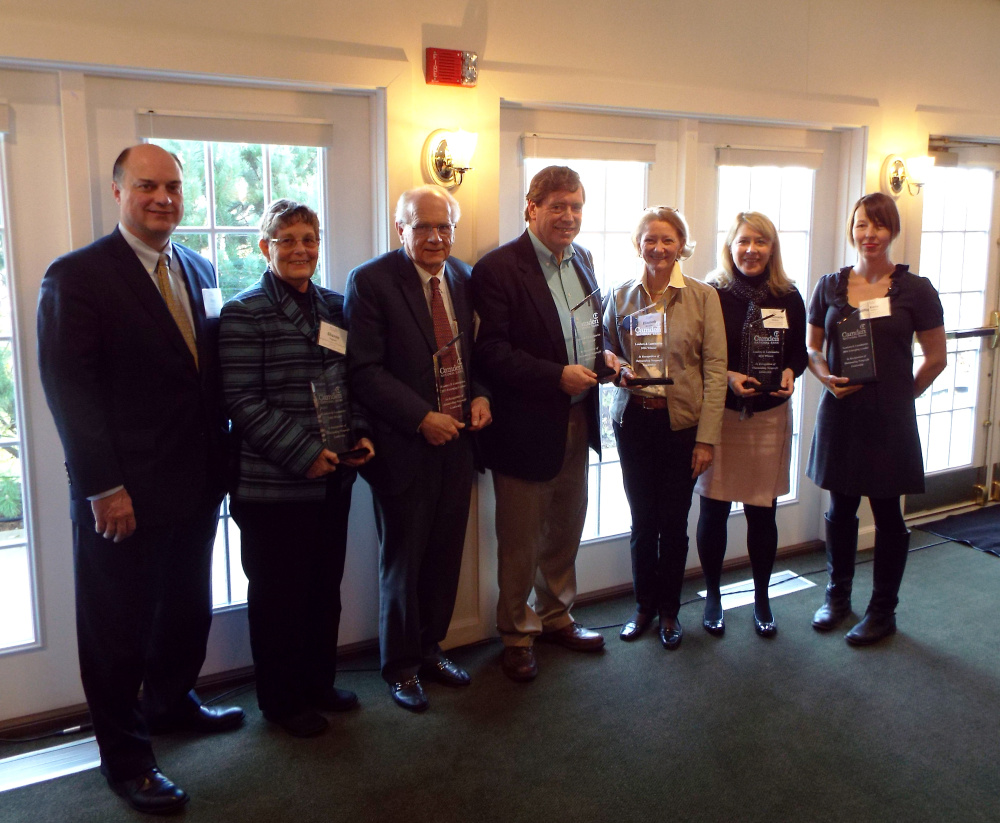 From left to right are Greg Dufour, Camden National Bank;  Sharon Goguen, Broadreach Family & Community Services; Dr. Richard Corbin, Oasis Free Clinics;  Dr. Allan S. Teel, ElderCare Network of Lincoln County; Elizabeth A. McLellan, Partners for World Health; Annemarie Albiston, Aphasia Center of Maine; and Katie Wallace, The Locker Project.