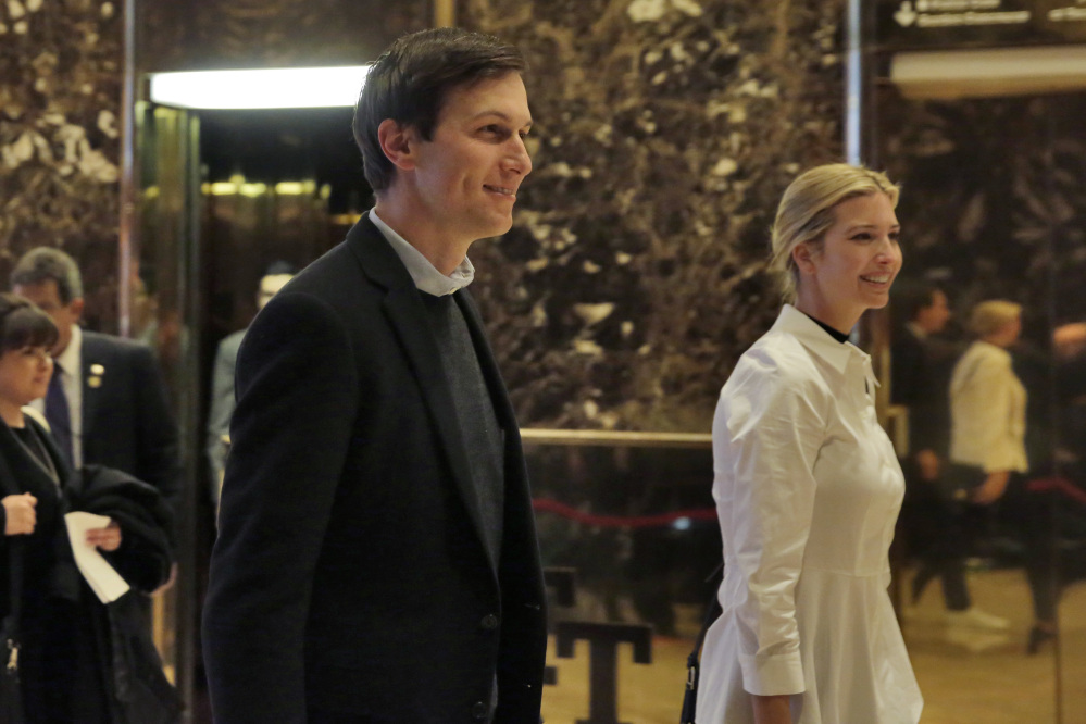 Jared Kushner and his wife Ivanka Trump walk through the lobby of Trump Tower in New York on Friday.
