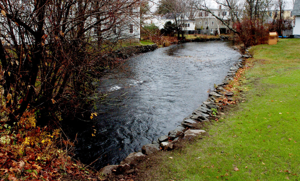 The Outlet Stream that flows out of China Lake in Vassalboro is full on Wednesday. Nearby resident Al Roy said the water is at a high level because the Kennebec Water District is flushing the lake of phosphorus by lowering dam gates.