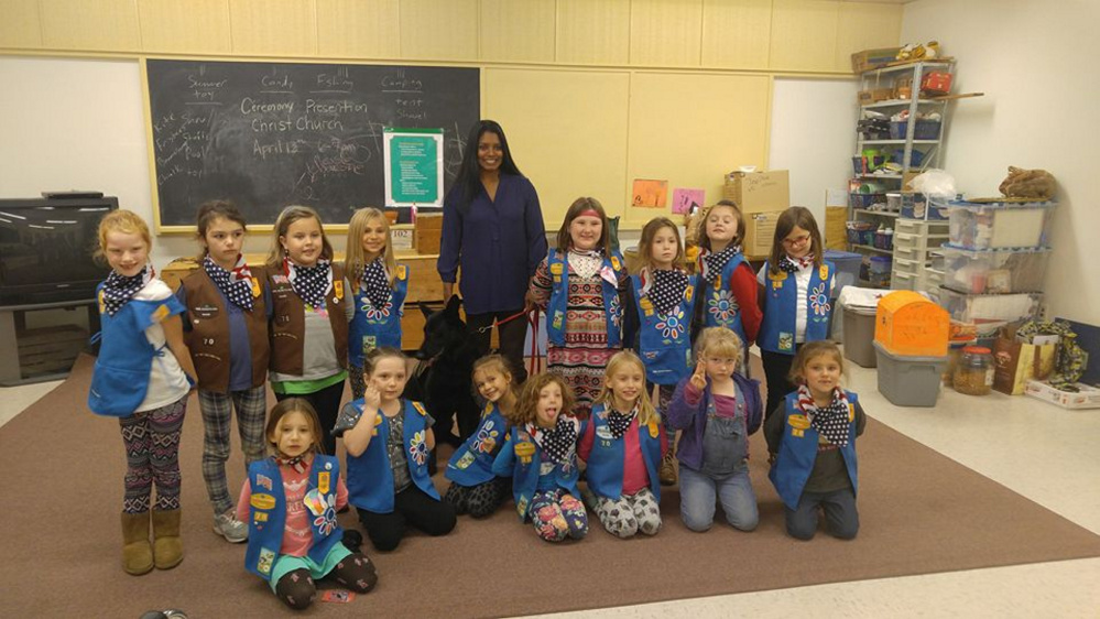 Girl Scout Daisy/Brownie Troop 70 from Gardiner welcomed Helania Lake, a disabled veteran, and her service dog, Xena, to their Nov. 9 meeting. Front, from left, are Sophie Moore, Emma Buzzell, Talia Migliaccio, Ada Phillips, Evy Kokmyer, Maddie Peters and Jayden Barber. Back, from left, are Rachel Grant, Emma Lee Briere, Victoria Tracey, Natalie Fikus, Xena (dog), Lake, Ashlyn Dutille, Amiah Graves, Ayla McCurdy and Riley Keyser.