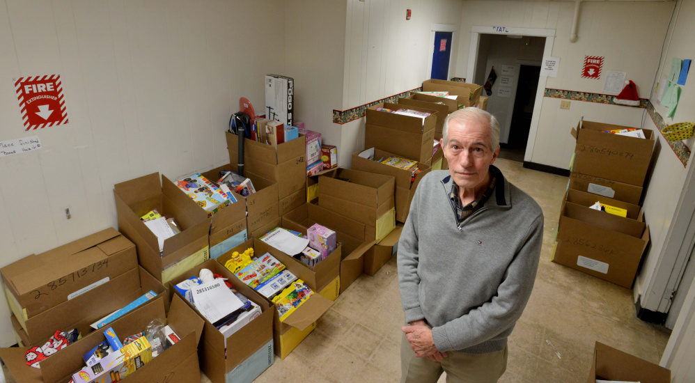 Steve Mayberry, development director at The Maine Children's Home for Little Wanderers, stands on Wednesday among boxes intended to be delivered to needy children for the Christmas season at the organization's home offices in Waterville. The nonprofit said Wednesday it still needs to fill about half of its boxes to meet its goal of serving more than 1,700 children this Christmas.