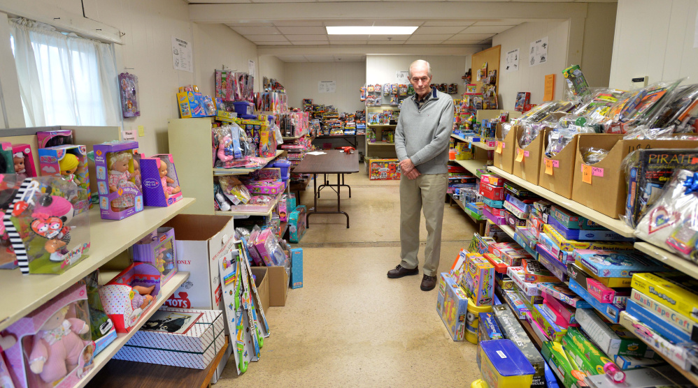 Steve Mayberry, development director at The Maine Children's Home for Little Wanderers, stands on Wednesday among presents intended to be delivered to needy children for the Christmas season at the organization's home offices in Waterville. The nonprofit said Wednesday it still needs to fill about half of its boxes to meet its goal of serving more than 1,700 children this Christmas.